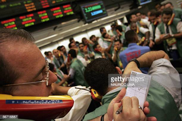 Stock traders negociate inside the new 'the spot dollar' pit after its launching at the Brazilian Mercantile Futures Exchange in Sao Paulo Brazil 01...