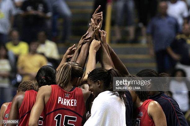 US basketball women team players cheer after defeating Brazil by 9959 during their FIBA World Championship for Women Brazil 2006 bronze medal game at...