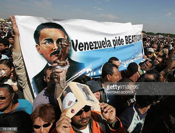 Venezuelan faithful hold a banner asking for the canonization of Venezuelan Doctor Jose Gregorio Hernandez during a mass celebrated by Pope Benedict...