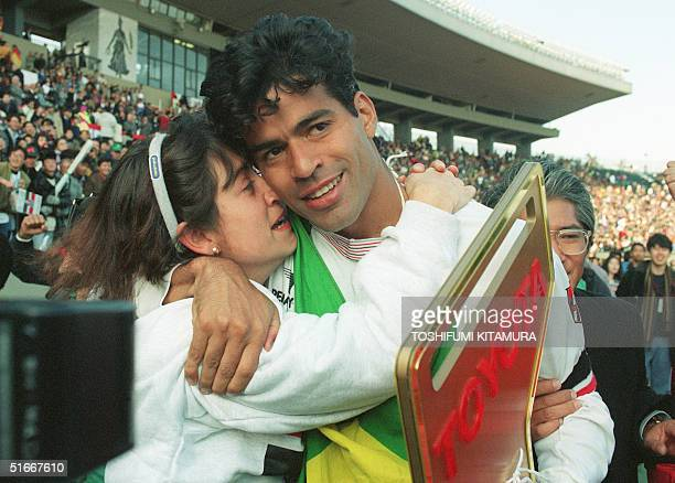 Sao Paulo Captain and star striker Rai hugs his wife after his team won the Inter-Continental Cup 13 December 1992 by beating FC Barcelona 2-1 in...