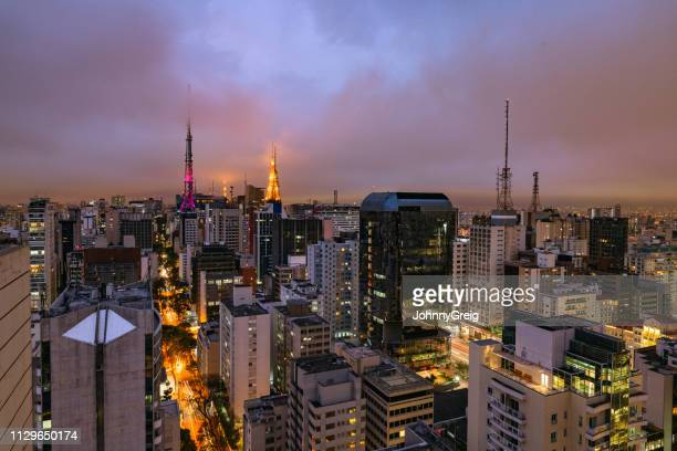 sao paulo city skyline at dusk - são paulo stock pictures, royalty-free photos & images