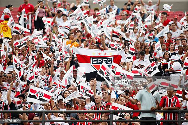 Sao Paulo fans cheer before the match between Sao Paulo and Figueirense for the Brazilian Series A 2014 at Morumbi stadium on November 30 2014 in Sao...