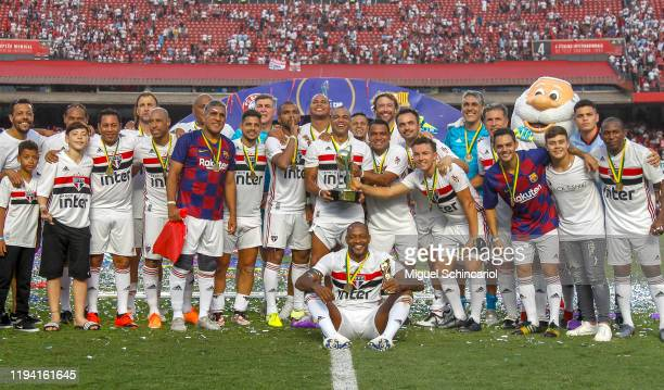 Sao Paulo FC players celebrate with their medals and the trophy after winning Legends Cup 2019 final between Sao Paulo FC and Barcelona at Morumbi...