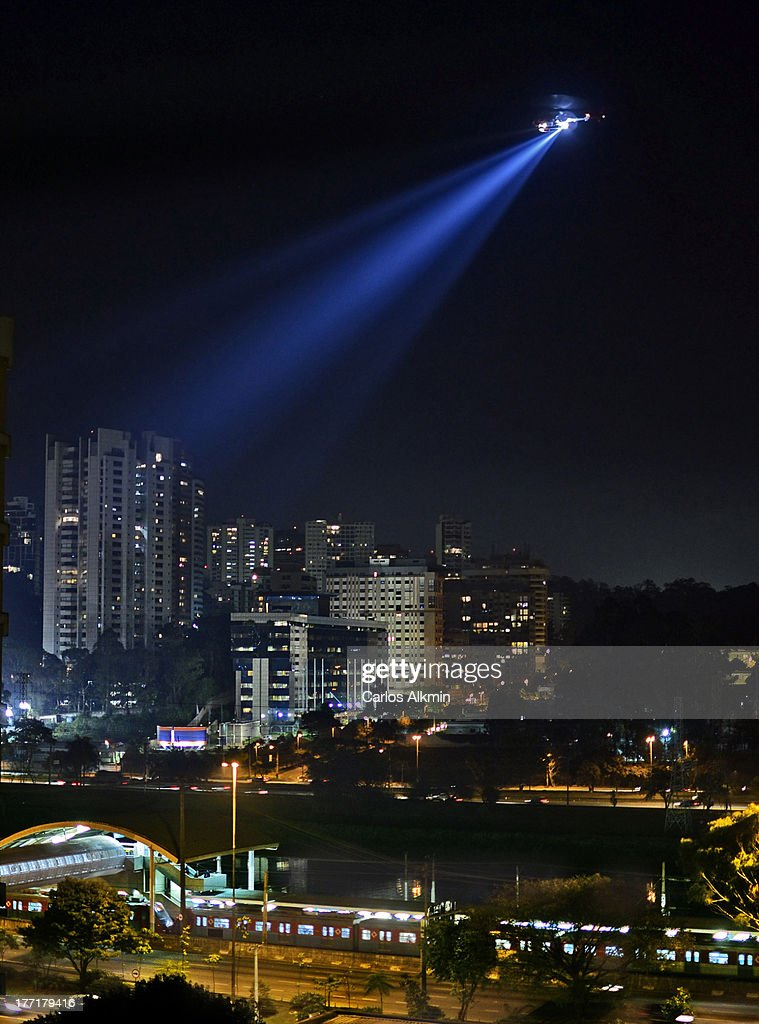 Sao Paulo night, police helicopter over station : Stock Photo