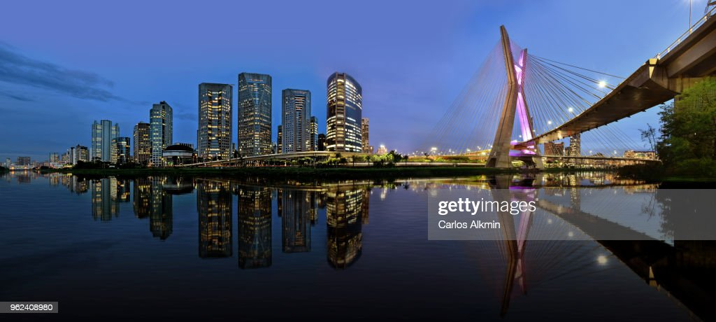 Sao Paulo skyline reflected on Pinheiros River at blue hour : Stock Photo