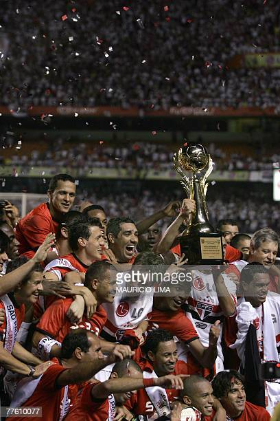 Sao Paulo's players celebrate with a symbolic trophy after beating America-RN 3-0 in their Brazilian League football match at Morumbi Stadium in Sao...