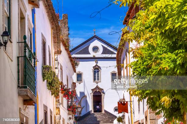 Sao Pedro Church and narrow white streets of medieval town, Obidos, Portugal