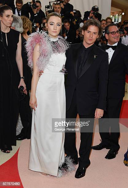 Saoirse Ronan and Christoper Kane attend the 'Manus x Machina: Fashion in an Age of Technology' Costume Institute Gala at the Metropolitan Museum of...