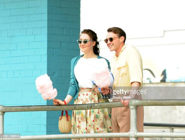 Saoirse Ronan and Emory Cohen on the set of Brooklyn on May 21 2014 in New York City