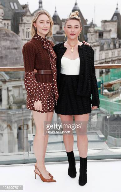 """Saoirse Ronan and Florence Pugh pose at a morning photocall for """"Little Women"""" at the Corinthia Hotel London on December 16, 2019 in London, England."""