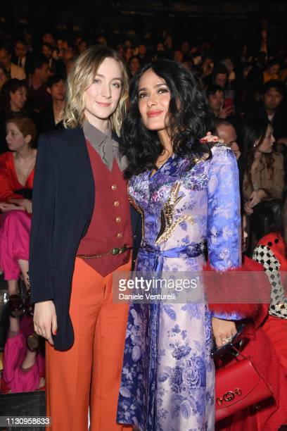 Saoirse Ronan and Salma Hayek Pinault attend the Gucci show during Milan Fashion Week Autumn/Winter 2019/20 on February 20 2019 in Milan Italy
