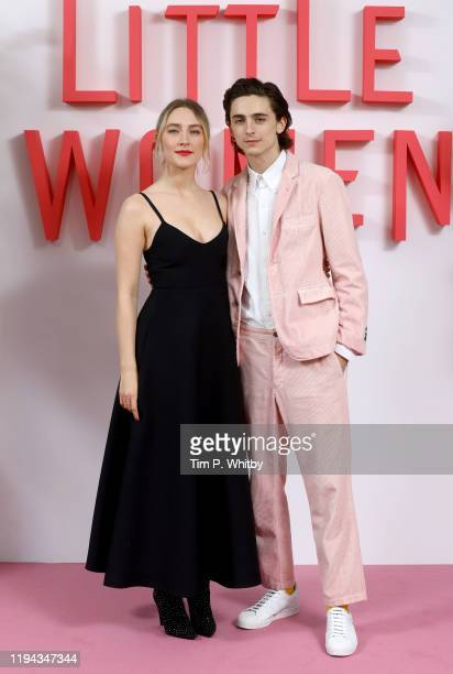 Saoirse Ronan and Timothee Chalamet attend the Little Women London evening photocall at the Soho Hotel on December 16 2019 in London England Little...