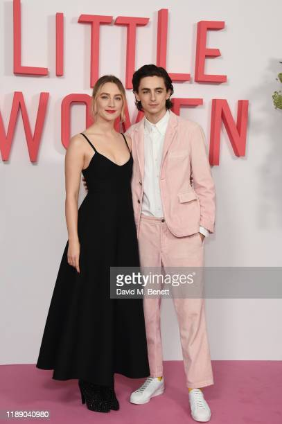 """Saoirse Ronan and Timothee Chalamet pose at the evening photocall for """"Little Women"""" at The Soho Hotel London on December 16, 2019 in London, England."""