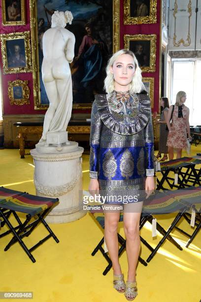 Saoirse Ronan attends the Gucci Cruise 2018 fashion show at Palazzo Pitti on May 29 2017 in Florence Italy