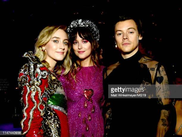 Saoirse Ronan Dakota Johnson and Harry Styles attend The 2019 Met Gala Celebrating Camp Notes on Fashion at Metropolitan Museum of Art on May 06 2019...