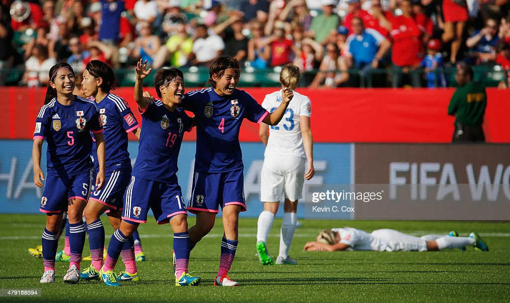Saori Ariyoshi and Saki Kumagai of Japan celebrate after the FIFA Women's World Cup Semi Final match between Japan and England at the Commonwealth Stadium on July 1, 2015 in Edmonton, Canada.