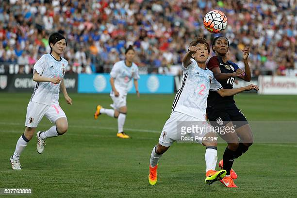 Saori Ariyoshi of Japan and Crystal Dunn of United States of America vie for control of the ball during an international friendly match at Dick's...