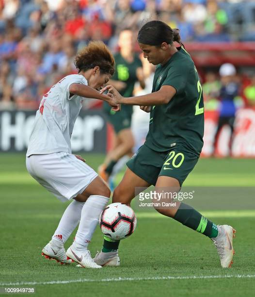 Saori Ariyoshi of Japan and Sam Kerr of Australia battle for the ball during the 2018 Tournament Of Nations at Toyota Park on August 2 2018 in...