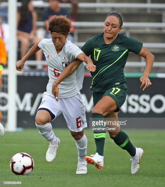 Saori Ariyoshi of Japan battles for the ball with Kyah Simon of Australia during the 2018 Tournament Of Nations at Toyota Park on August 2 2018 in...