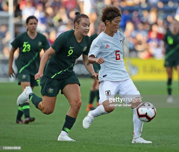 Saori Ariyoshi of Japan passes in front of Caitlin Foord of Australia during the 2018 Tournament Of Nations at Toyota Park on August 2 2018 in...