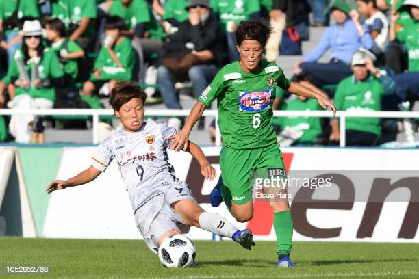 Saori Ariyoshi of NTV Beleza and Rika Masuya of INAC Kobe compete for the ball during the Nadeshiko League match between NTV Beleza and INAC Kobe...