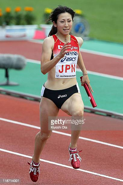 Saori Imai of Japan competes to win the team gold medal in a time of 4405 in the Women's 4x100m Relay final during the day four of the 19th Asian...
