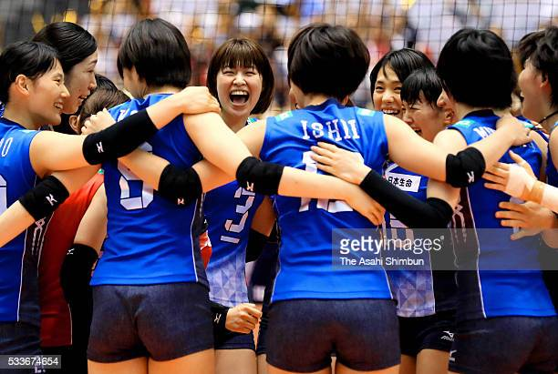 Saori Kimura and Japan team celebrate after the Women's World Olympic Qualification game between Netherlands and Japan at Tokyo Metropolitan...