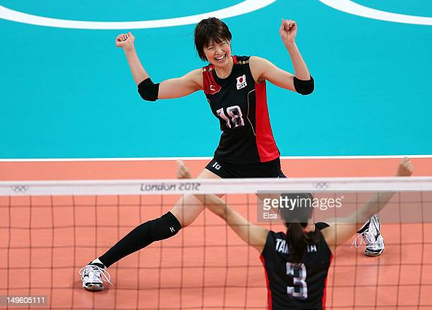 Saori Kimura and Yoshie Takeshita of Japan celebrate a point in the second set against Dominican Republic during Women's Volleyball on Day 5 of the...