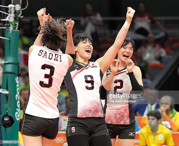Saori Kimura Haruyo Shimamura and Haruka Miyashita of Japan celebrate a point during the Women's preliminary volleyball match between Japan and...