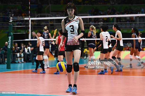 Saori Kimura of Japan prepares to serve during the Women's Quarterfinal match between Japan and The United States on day 11 of the Rio 2106 Olympic...
