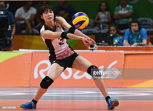 Saori Kimura of Japan receives the ball during the Women's Quarterfinal match between Japan and The United States on day 11 of the Rio 2106 Olympic...
