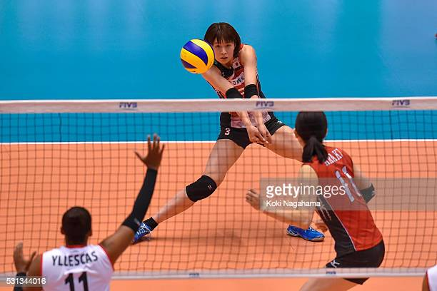 Saori Kimura of Japan receives the ball during the Women's World Olympic Qualification game between Japan and Peru at Tokyo Metropolitan Gymnasium on...