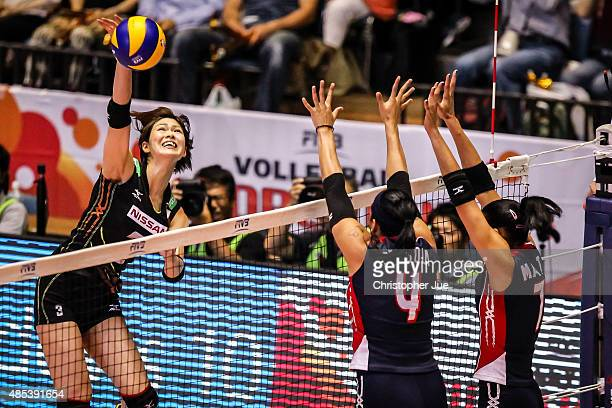 Saori Kimura of Japan spikes in the match between Dominican Republic and Japan during the FIVB Women's Volleyball World Cup Japan 2015 at Yoyogi...