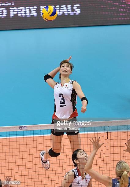 Saori Kimura of Japan spikes the ball during day five of the FIVB World Grand Prix Sapporo 2013 match between USA and Japan at Hokkaido Prefectural...