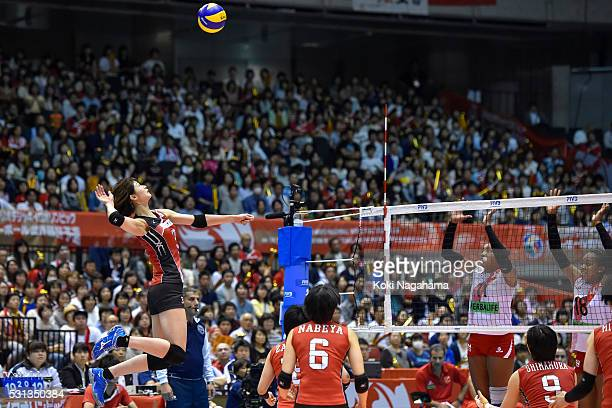 Saori Kimura of Japan spikes the ball during the Women's World Olympic Qualification game between Japan and Peru at Tokyo Metropolitan Gymnasium on...