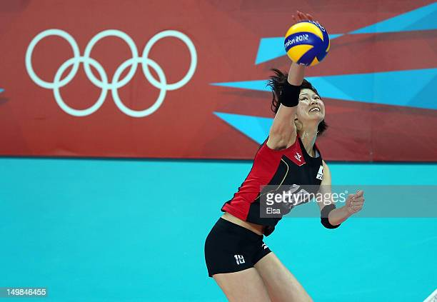 Saori Kimura of Japan spikes the ball in the first set against Great Britain during Women's Volleyball on Day 9 of the London 2012 Olympic Games at...