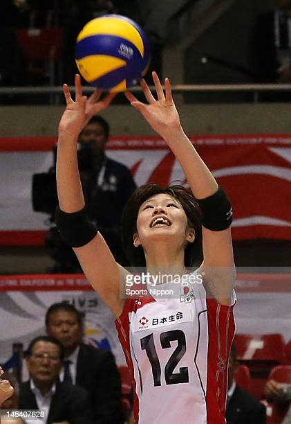 Saori Kimura of Japan tosses the ball during the FIVB Women's World Olympic Qualification tournament match between Japan and Cuba at Yoyogi Gymnasium...