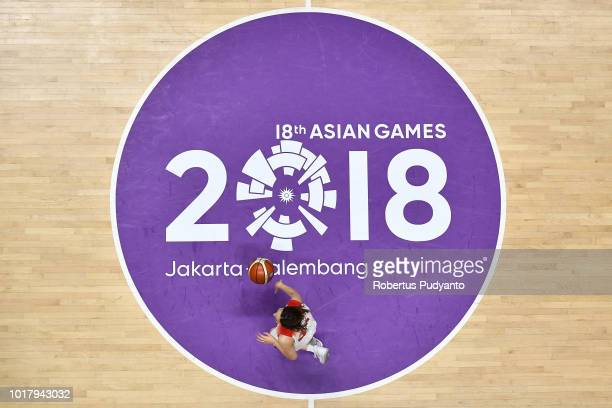 Saori Miyazaki of Japan dribbles during the WomenÕs Basketball Preliminary round between Japan and China in the Asian Games 2018 at Hall A Gelora...