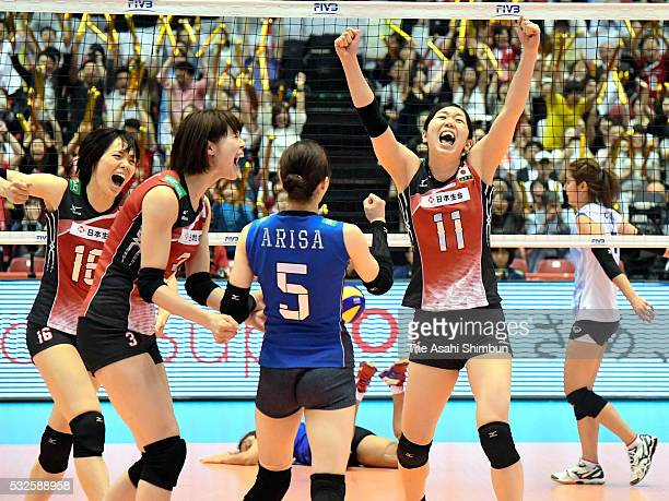 Saori Sakoda Saori Kimura Arisa Sato and Erika Araki of Japan celebrate their win over Thailand after the Women's World Olympic Qualification game...