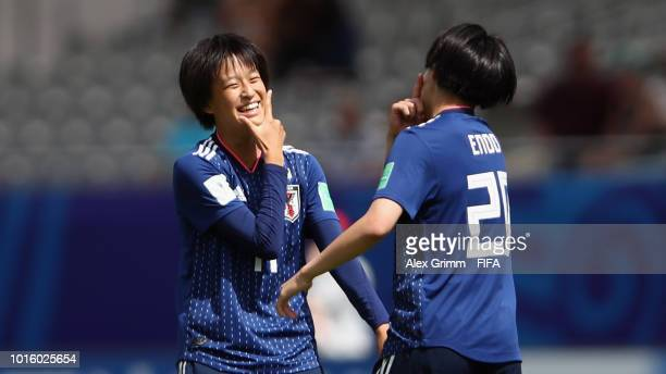 Saori Takarada of Japan celebrates her team's first goal with team mate Jun Endo during the FIFA U20 Women's World Cup France 2018 group C match...