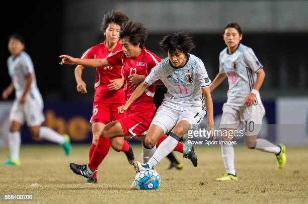 Saori Takarada of Japan fights for the ball with Kim Jong Sim of DPR Korea during their AFC U19 Women'u2019s Championship 2017 Final match between...