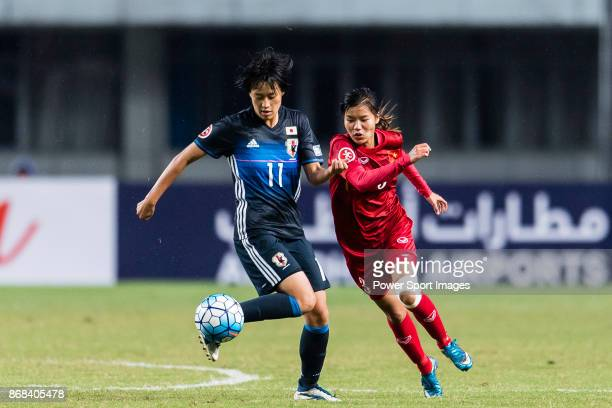 Saori Takarada of Japan fights for the ball with Luong Thi Thu Thuong of Vietnam during their AFC U19 Women'u2019s Championship 2017 Group Stage B...