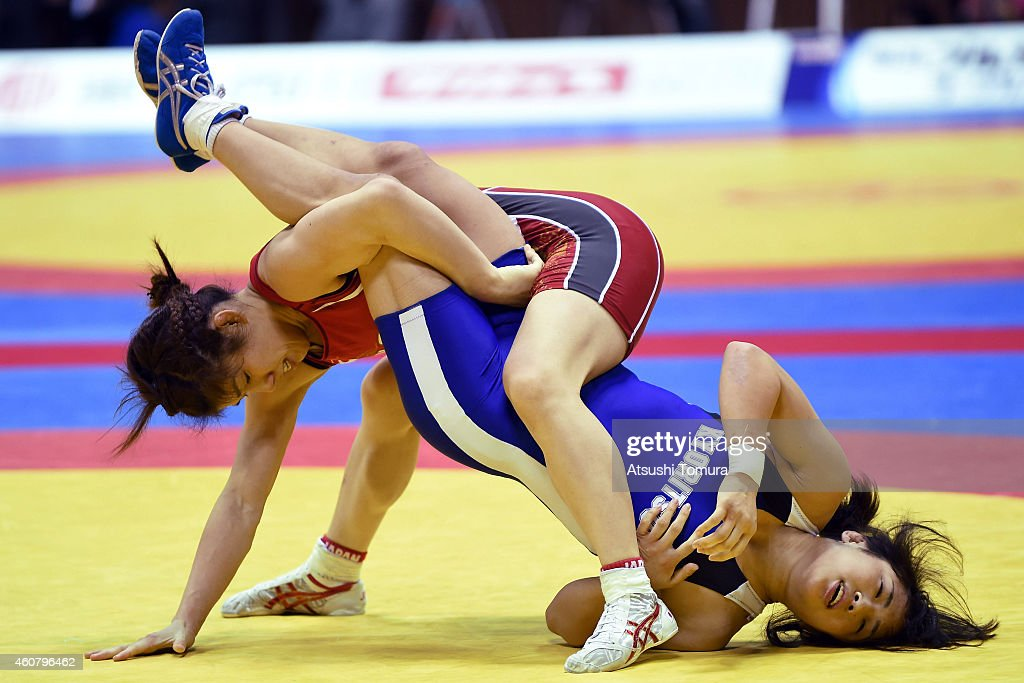 Saori Yoshida (Red) and Nanami Irie (Blue) compete in Women's 53kg free style during 2014 Emperor's Cup All Japan Wresting Championship on December 23, 2014 in Tokyo, Japan.