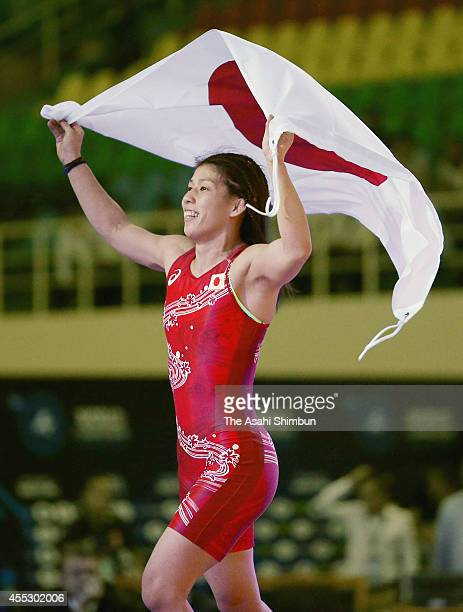 Saori Yoshida of Japan celebrates after winning the gold medal in the Women's 53kg during day four of the FILA World Wrestling Championships at...