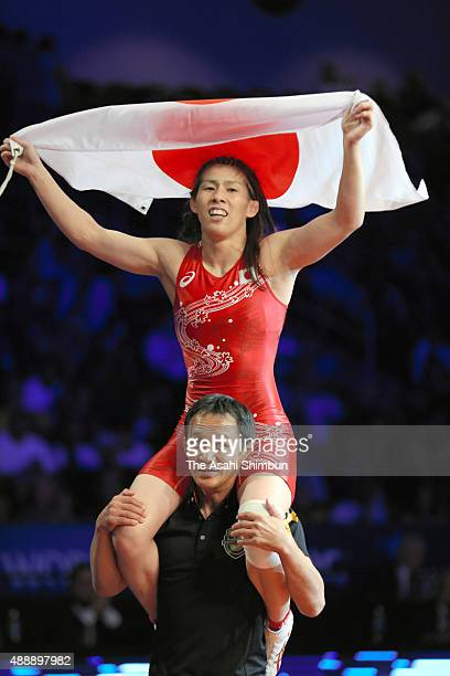 Saori Yoshida of Japan celebrates winning gold in the Women's Freestyle -53kg during day three of the World Wrestling Championships at the Orleans...