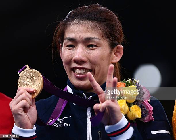 Saori Yoshida of Japan celebrates winning the gold medal in the Women's Freestyle 55 kg Wrestling on Day 13 of the London 2012 Olympic Games at ExCeL...