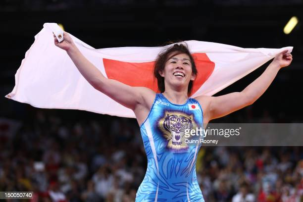 Saori Yoshida of Japan celebrates winning the gold medal over Tonya Lynn Verbeek of Canada in the Women's Freestyle 55 kg Wrestling on Day 13 of the...