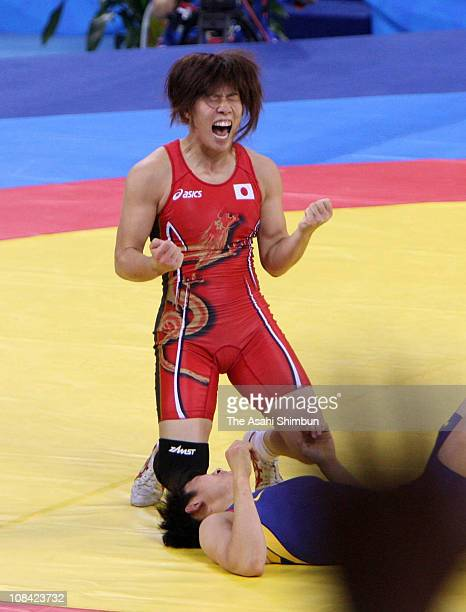 Saori Yoshida of Japan cleberates the gold medal after defeating Xu Li of China in the women's 55kg freestyle wrestling at the China Agriculture...
