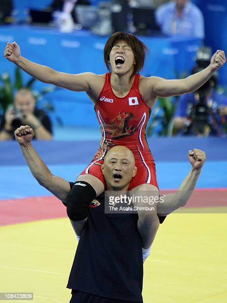 Saori Yoshida of Japan cleberates the gold medal with the Japan Women's wrestling head coach Kazuhito Sakae after defeating Xu Li of China in the...