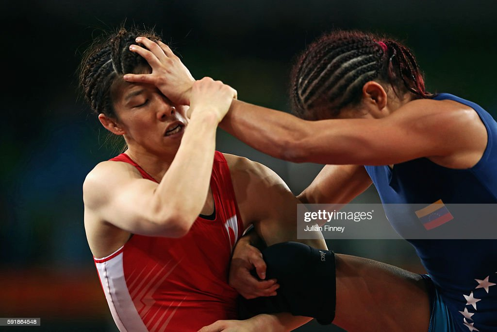 Saori Yoshida of Japan (red) competes against Betzabeth Angeli Arguello Villegas of Venezuela during the Women's Freestyle 53 kg Semifinals match on Day 13 of the Rio 2016 Olympic Games at Carioca Arena 2 on August 18, 2016 in Rio de Janeiro, Brazil.